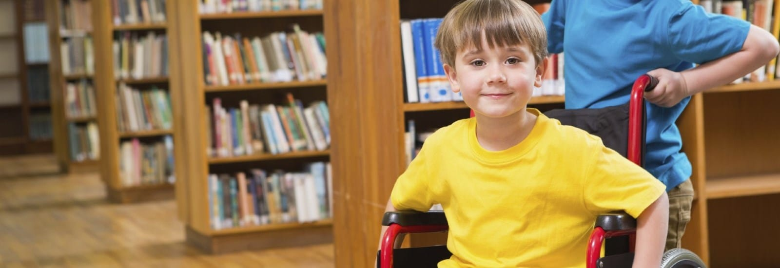 Boy in wheelchair in library