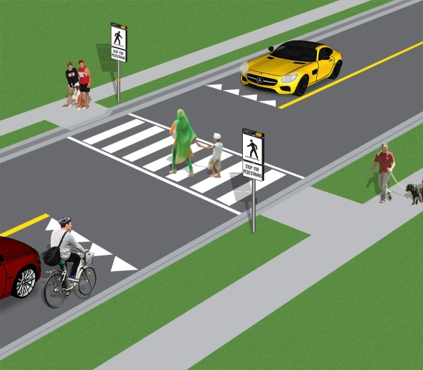 Image of people crossing at a level 2 pedestrian crossover
