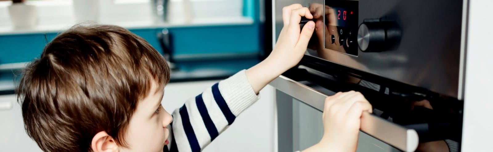 Child Turning On Stove